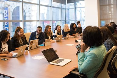 diverse employees at conference table
